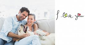 image of cursive  - Happy couple petting their yellow labrador on the couch against i love you - JPG