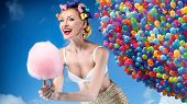 foto of candy cotton  - Beautiful crazy girl holding sweet candy cotton - JPG