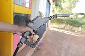 stock photo of gasoline station  - oil gasoline dispenser at petrol filling station - JPG
