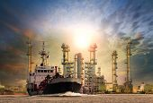 pic of lng  - gas tanker ship and oil refinery plant background use for oil fuel energy and fossil power  - JPG