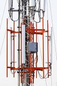 image of wiretap  - Close up antenna repeater cell tower in city - JPG