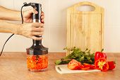 picture of blender  - Hands of cook chopped red pepper in a blender - JPG