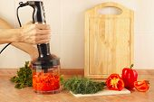 stock photo of blender  - Hands of cook are going to mix red pepper and tomato in a blender - JPG