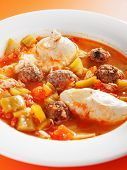 stock photo of meatball  - Tunisian soup with meatballs and eggs shot from below - JPG