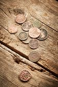 pic of copper coins  - Ancient coins on the old wooden background - JPG