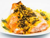 picture of saffron  - Salmon with sauce of saffron onion and rosemary served in white plate - JPG