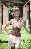 stock photo of corset  - Beautiful young woman in corset and shorts outdoor - JPG