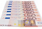 stock photo of fifties  - Fifty euro notes row isolated on white background - JPG