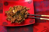 stock photo of stir fry  - Vietnamese beef stir fry served on a silk table cloth - JPG
