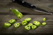 image of chillies  - Chopped Fresh green chilli pepper On A rustic Wooden Board - JPG