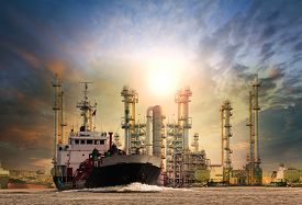 foto of fuel tanker  - gas tanker ship and oil refinery plant background use for oil fuel energy and fossil power  - JPG