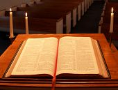 image of mennonite  - the view from the pulpit in a small mennonite church in perkasie pennsylvania. the bible on the pulpit is opened to psalm 23. candles provide a warm light source.