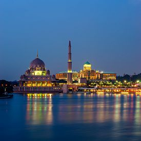 stock photo of prime-minister  - Reflection of Putra Mosque and Prime Minister Office at dusk in Putrajaya Malaysia - JPG