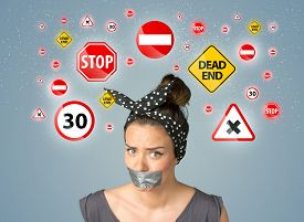 foto of traffic signal  - Young woman with taped mouth and traffic signals around her head - JPG