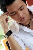picture of teenage boys  - photo of an asian male student thinking - JPG