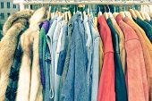 Vintage Second Hand Clothes Hanging On Shop Rack At Weekly Flea Market - Hipster Wardrobe Sale Conce poster
