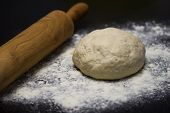 Постер, плакат: Homemade Pizza Dough With Rolling Pin On The Wooden Table