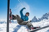 Cheerful man playing with snow while sit with ski. Happy smiling skier enjoying sitting on snow with poster