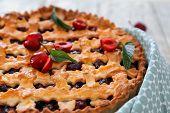 Tasty cherry pie on table, closeup poster