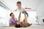 Male gay couple playing with foster son. Adoption concept poster