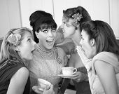 picture of foursome  - Group of four excited housewives in a kitchen share secrets - JPG
