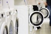 Washing machines, dryer and other domestic appliance equipment in the store. focus at equipment, def poster