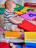 Child jigsaw develops children. Kid puzzle making baby. Little boy holding big pieces. Playing on fl poster