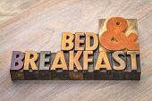 Bed and breakfast word abstract in vintage letterpress wood type poster