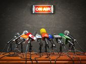 Press conference or interview on air.  Microphones of different mass media, radio, tv and press prep poster
