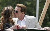 LOS ANGELES - APRIL 2: Maria Shriver kisses husband governor Arnold Schwarzenegger at the softball g