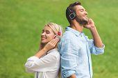 Couple Listening Music In Headphones poster