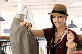 Portrait of happy young woman smiling - small business owner - woman working in fashion design busin poster