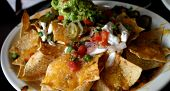 foto of mexican food  - Deluxe Serving of Nachos Grande in Mexican Restaurant - JPG