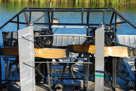 picture of airboat  - Rear view of airboat awaiting passengers at swamp land - JPG