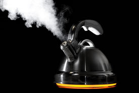 picture of boiling water  - Tea kettle with boiling water on black background - JPG