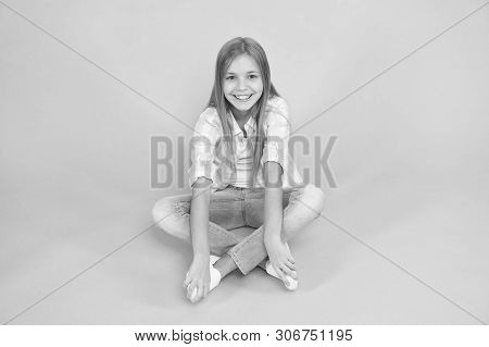 poster of Find Place To Relax. Girl Happy Face Sit On Floor Attentive Looking At Camera Turquoise Background.