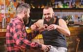 Friends Relaxing In Pub. Drunk Conversation. Cheers Concept. Hipster Brutal Bearded Man Drinking Alc poster