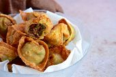 Deep Fried Crispy Wontons Filled With Minced Beef poster