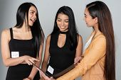 Two models meeting with a casting director at a modeling agency poster