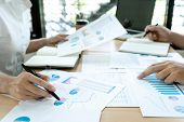 Business Businessman In Meeting Analyses Chart Graphy Marketing Plan In Business Project poster