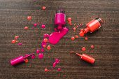 Spilled Orange And Pink Nail Polishes On Wooden Background. Nail Polish Drops. Blot Of Nail Polish O poster