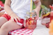 Strawberry And Mint Infused Detox Water. Strawberry Lemonade With Ice And Mint As Summer Refreshing poster