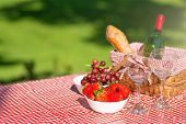 Picnic Basket Checkered With A Tablecloth Wine, Baguette, Strawberry, Glasses, Banner poster