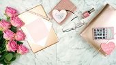Ultra Feminine Pink Desk Workspace With Rose Gold Accessories Flatlay Copyspace. poster