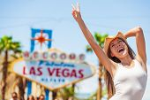Las Vegas sign USA vacation fun american tourist cowgirl woman on road trip travel screaming of joy  poster