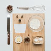 Baking Tools And Ingredients: Flour And Eggs, Butter, Rose Buds, Chocolate Dragee, Pastry Bag Nozzle poster