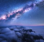 Bright Milky Way Over The Low Clouds, Mountains And Sea Coast At Starry Night In Summer. Aerial View poster