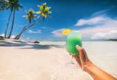 Blue Hawaiian drink cocktail woman drinking curacao liqueur on beach vacation travel in Caribbean de poster