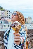 Young Woman Holding Icecream In Manarola In The Unesco World Heritage Site Cinque Terre, Liguria, It poster