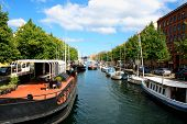 Colorful Copenhagen Buildings And Water Canal In Denmark. Tourist Area In Copenhagen With Boats. poster